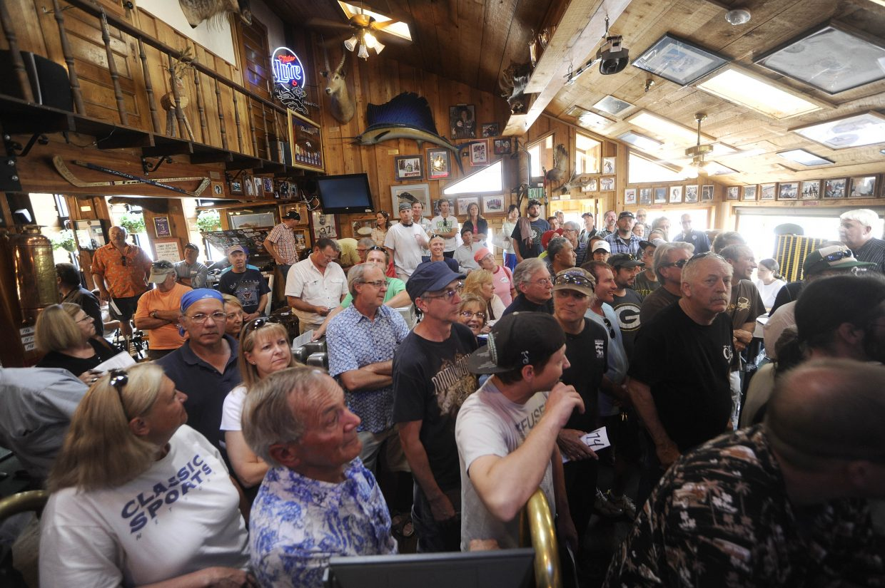 Bidders fill The Tugboat Grill & Pub during Wednesday's auction.