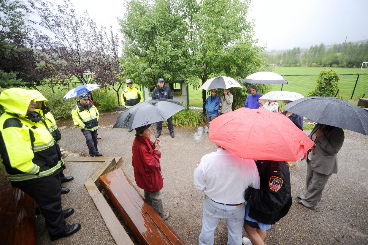 """Routt County resident Harriet Freiberger, middle, leads a Sept. 11 remembrance ceremony Wednesday at the Yampa River Botanic Park. The group shared stories, had a moment of silence and sang """"God Bless America."""""""