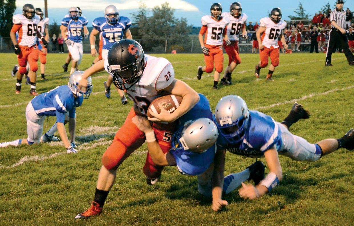 Steamboat's Billy Clark, No. 22, is brought down after making a catch in the first half of the Sailors' game at Moffat County on Friday. Clark returned the opening kickoff for a touchdown and later had an interception return for a touchdown. Steamboat routed Moffat, 57-15.