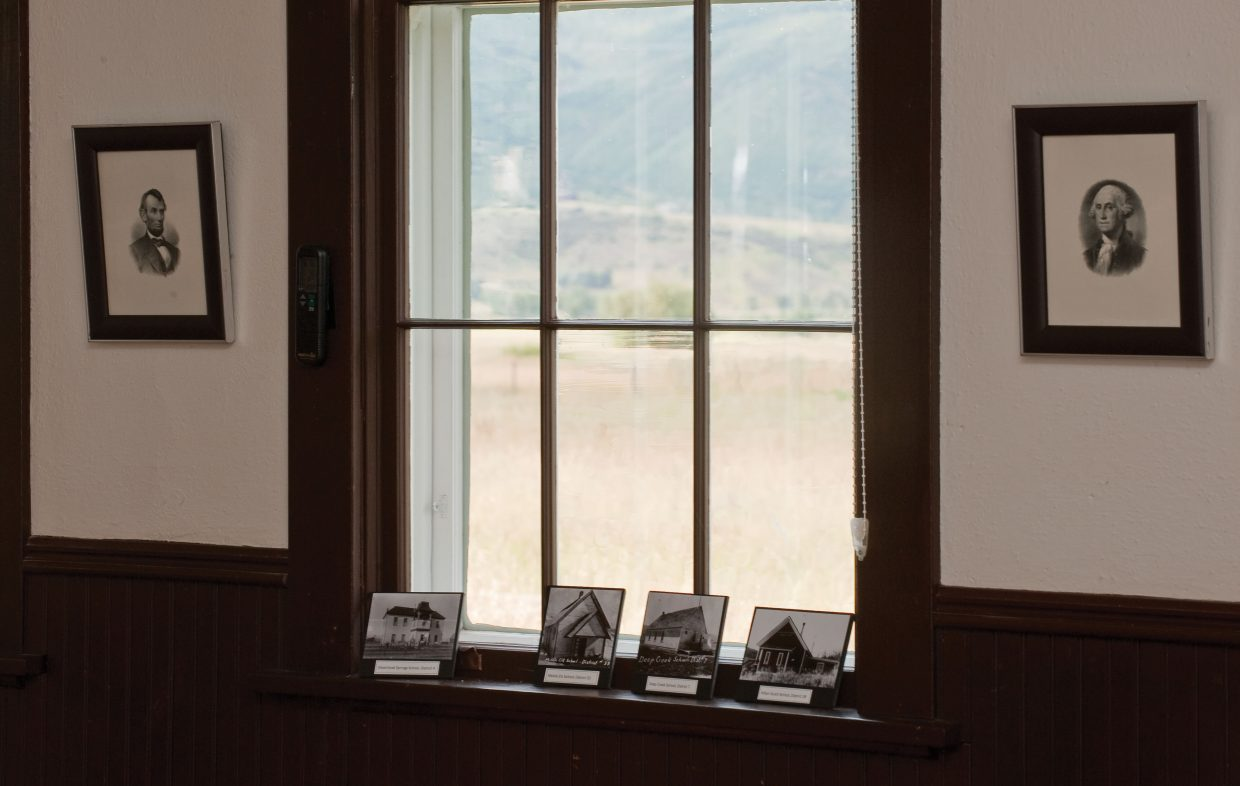 The view from inside the Mesa Schoolhouse has changed little since the early days of education in Routt County, but the desks, chalkboards and pictures of early presidents remind us all that the times have changed.