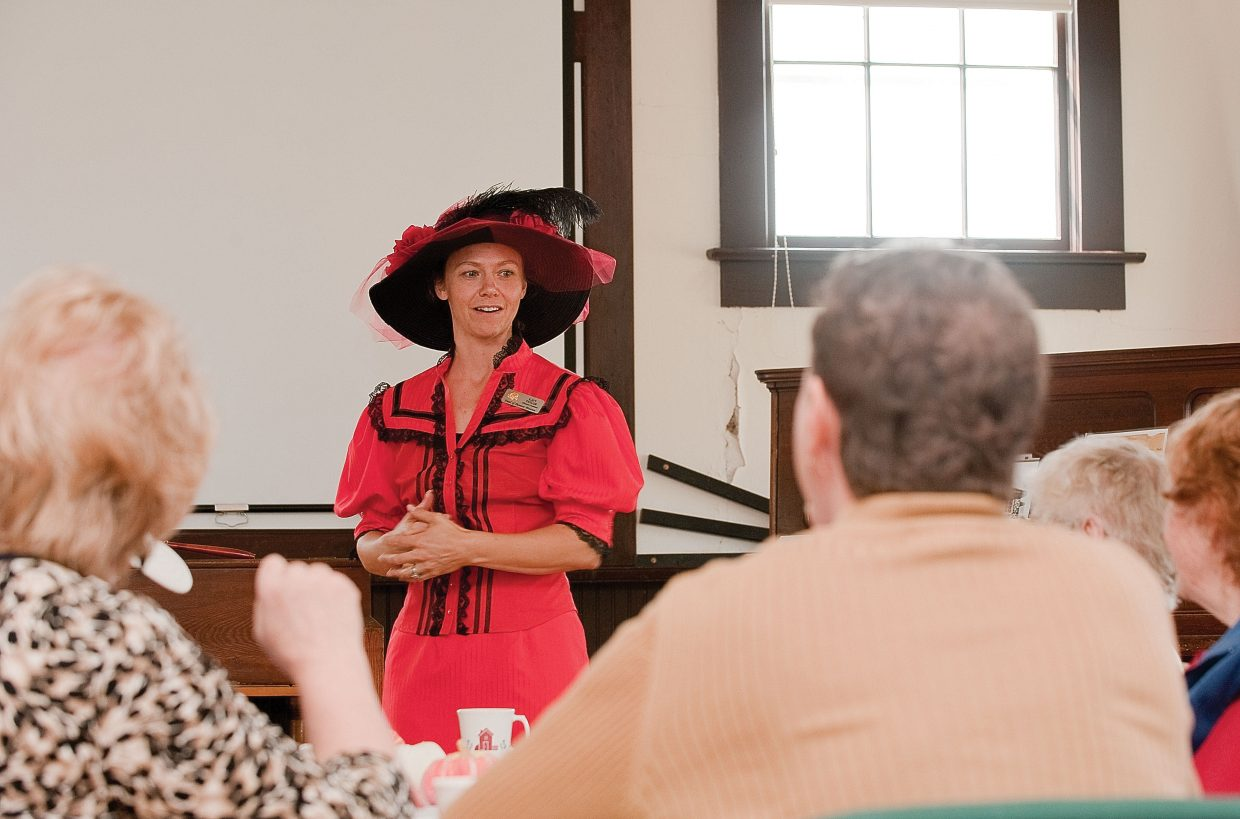 Katy Taylor, with the Tread of Pioneers Museum, speaks about the history of one-room schoolhouses at the Mesa School House during a tea Monday afternoon hosted the city of Steamboat Springs' Parks, Open Space and Recreational Services Department.