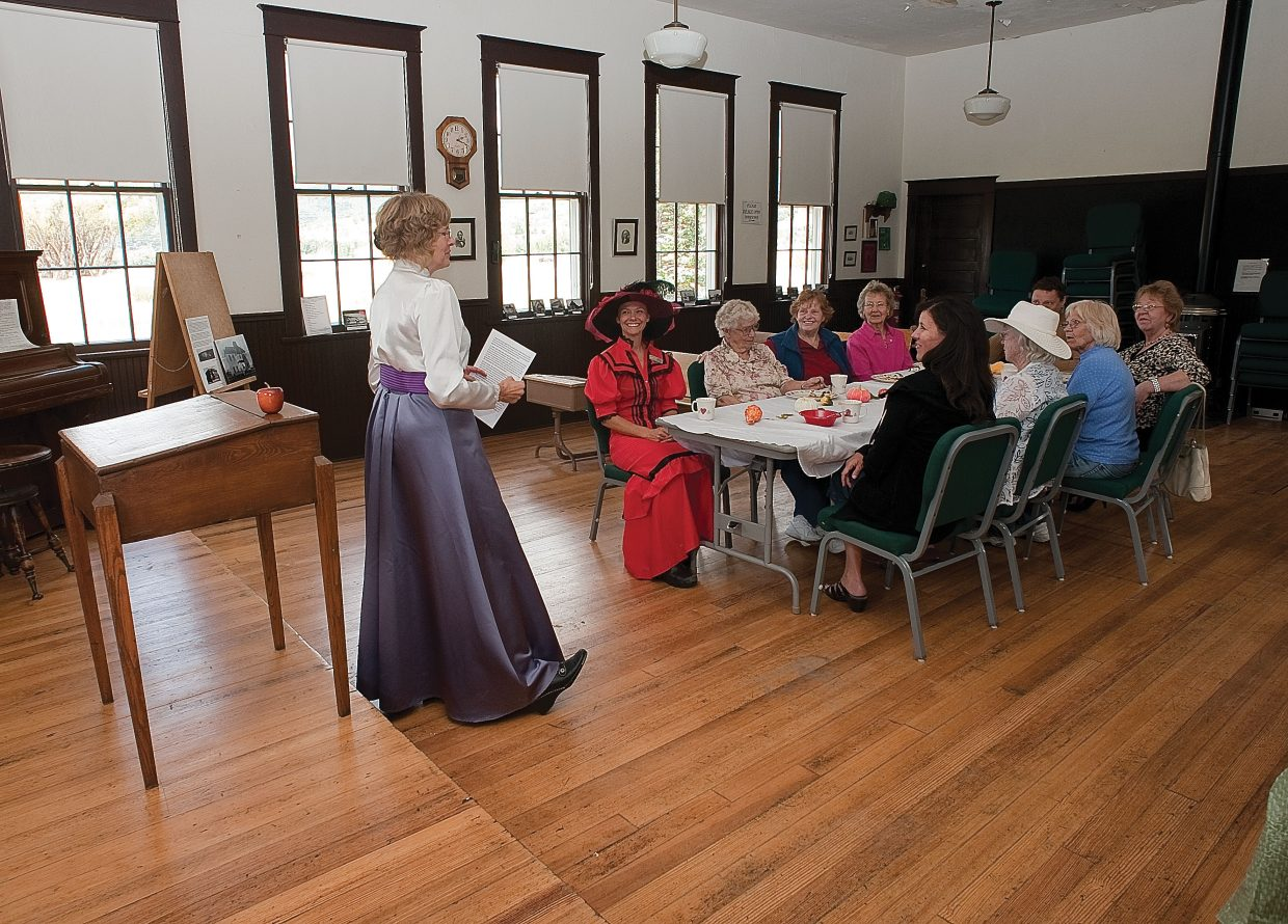 Cheri Daschle talks about the early days of education in Routt County at the Mesa School House near the base of Rabbit Ears Pass during a tea party Monday afternoon. Daschle, whose grandmother was one of the first teachers in Routt County, was invited to speak by the Tread of Pioneers Museum.