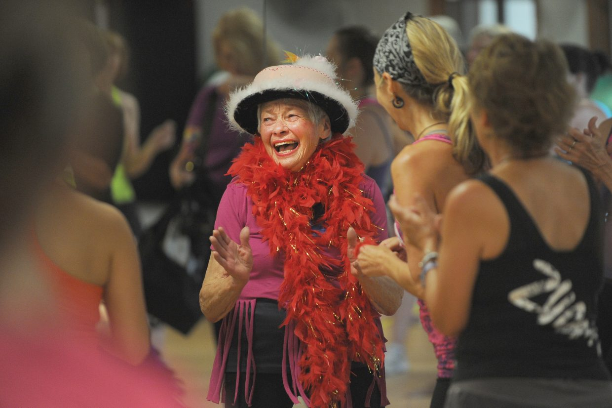 Giselle Miller, who turns 80 on Friday, celebrates with her Zumba class at Old Town Hot Springs on Thursday morning. Miller attends the class three times per week.