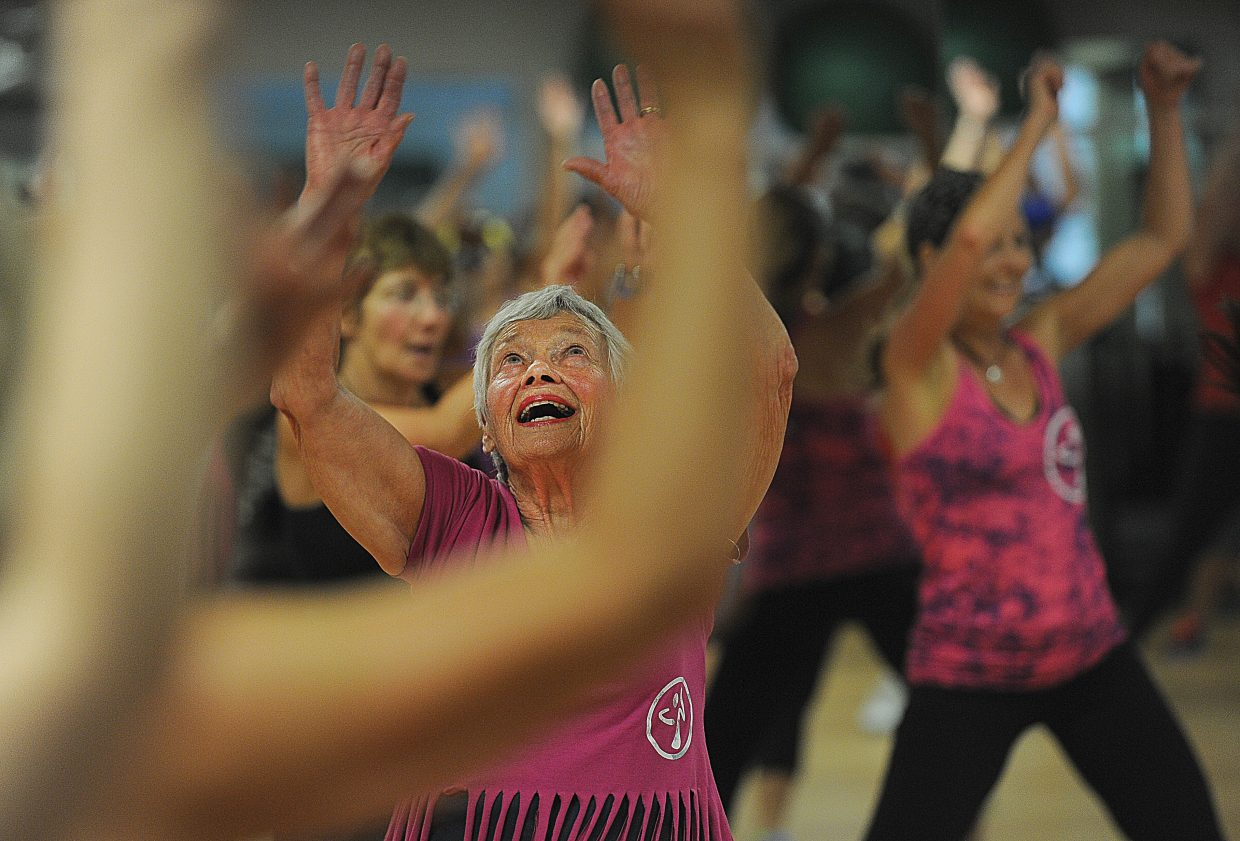 Giselle Miller, who turns 80 on Friday, participates in a Zumba class at Old Town Hot Springs on Thursday morning.