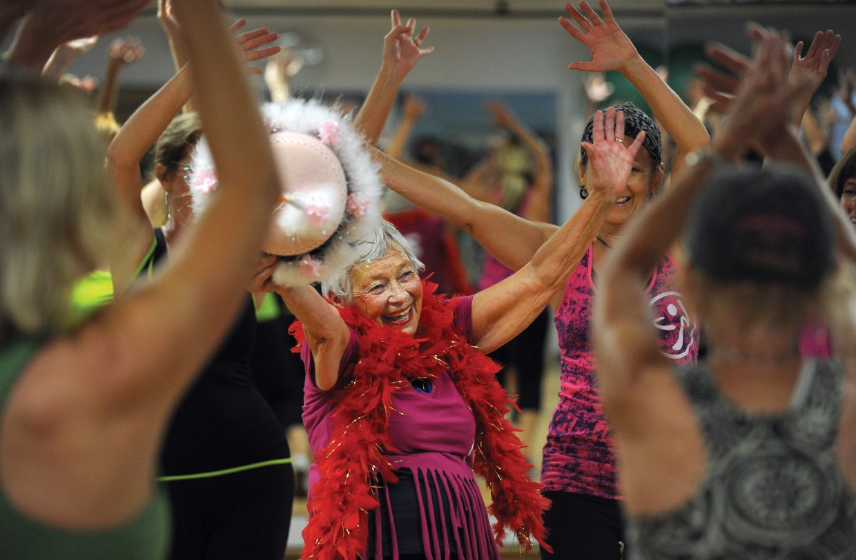 Giselle Miller, who turns 80 on Friday, celebrates with her Zumba class at Old Town Hot Springs on Thursday morning.