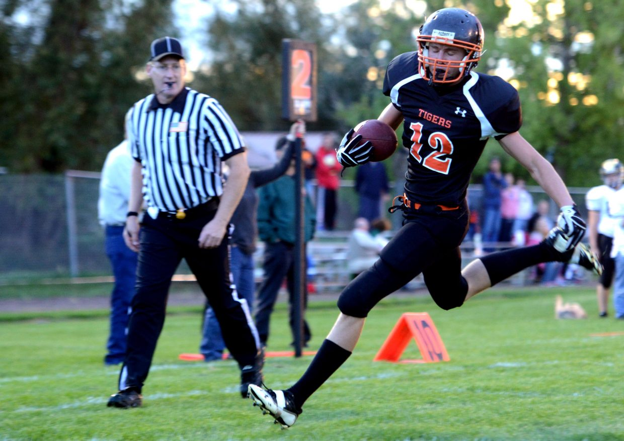 Hayden's Greg Frentress sprints toward the end zone, eyes closed. He made it, putting the Tigers on the board in the first quarter of Friday night's big win against Rocky Mountain Lutheran.