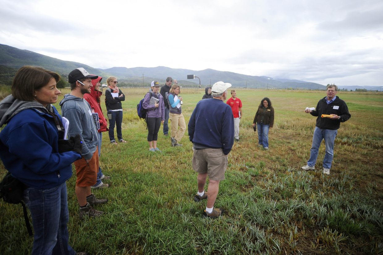 """University of Colorado biology and ecology professor Tim Seastedt speaks to teachers from across Colorado at the Legacy Ranch on Saturday as part of the Colorado Biology Teachers Association workshop """"Takin' it to the Field."""""""