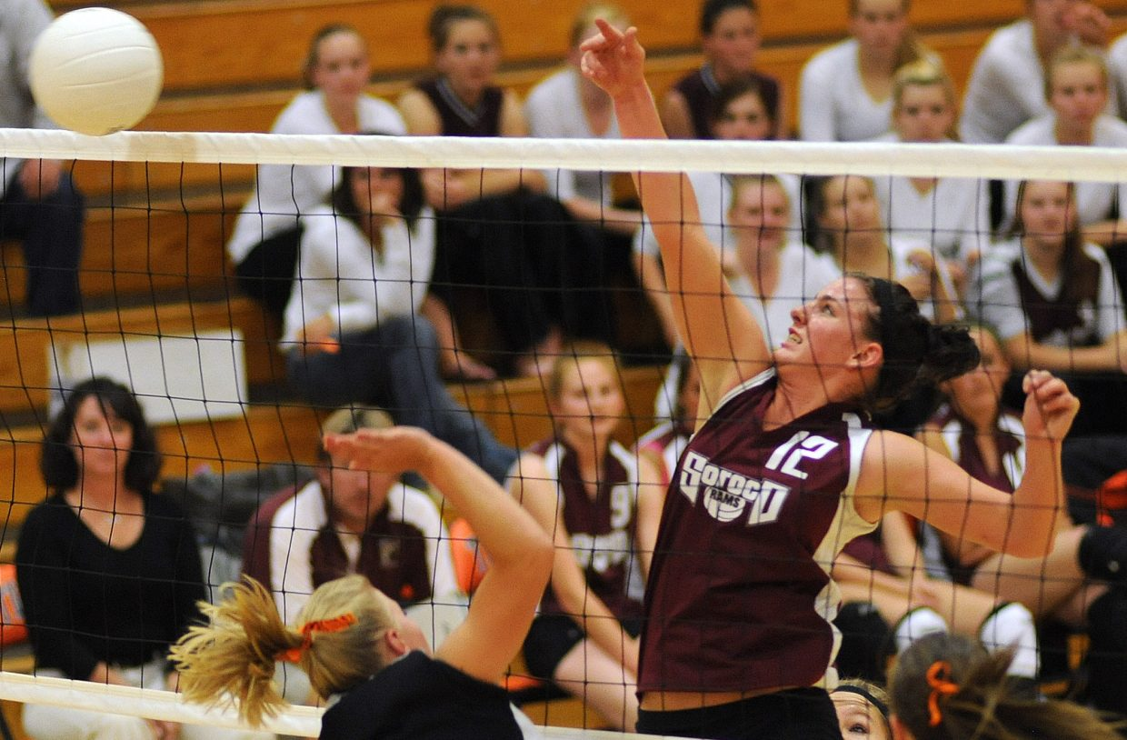 Soroco's Shelby Miles taps the ball over the net Friday against Hayden.