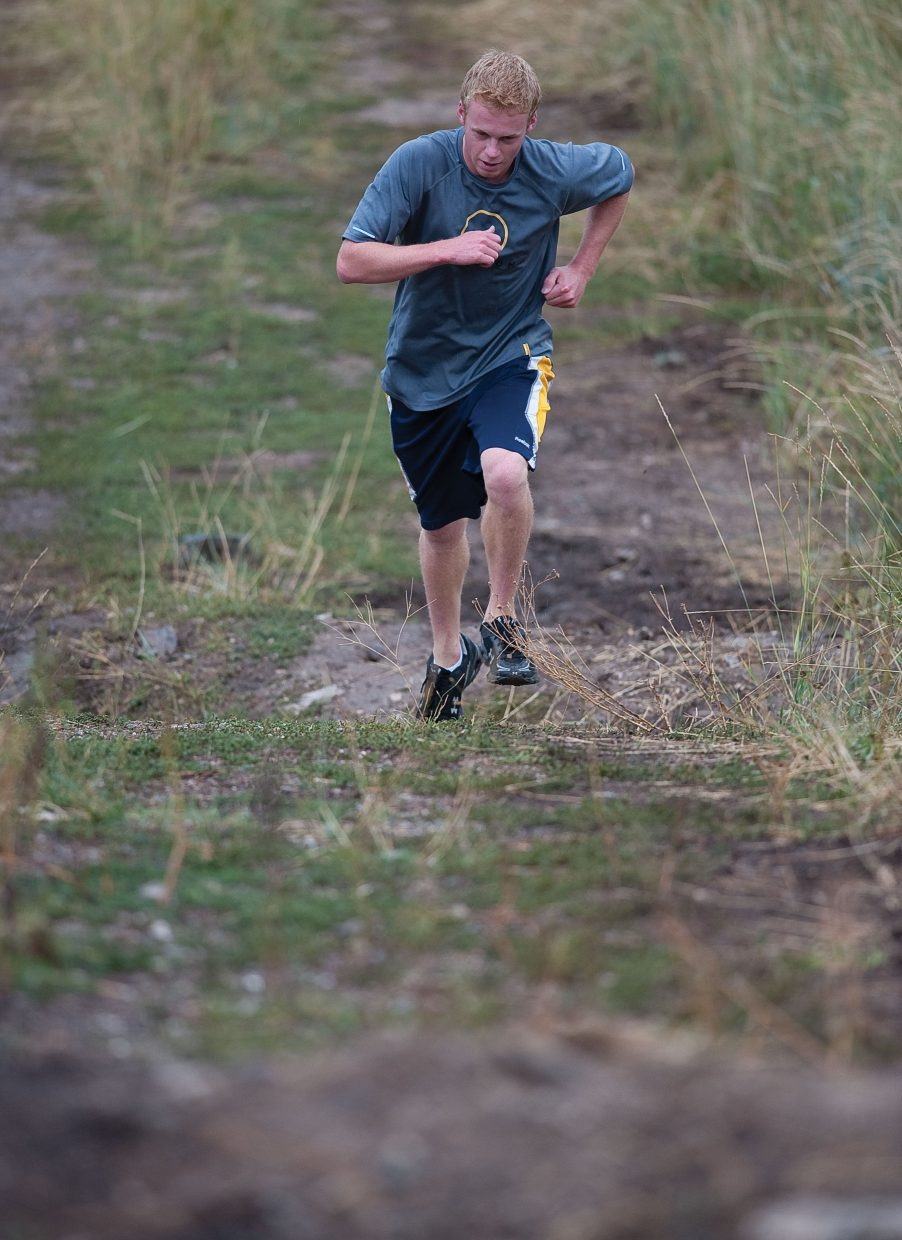 Colorado Mountain College skier John Zilverberg runs up a hill during a training session at Howelsen Hill.