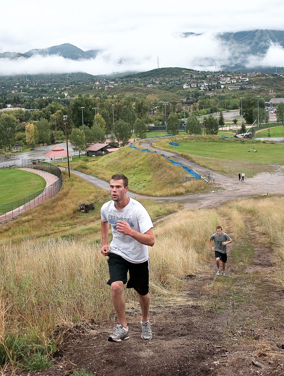 Colorado Mountain College Alpine skiers Ritch Carr and Jake Bell run up a hill during a training session on Thursday at Howelsen Hill.