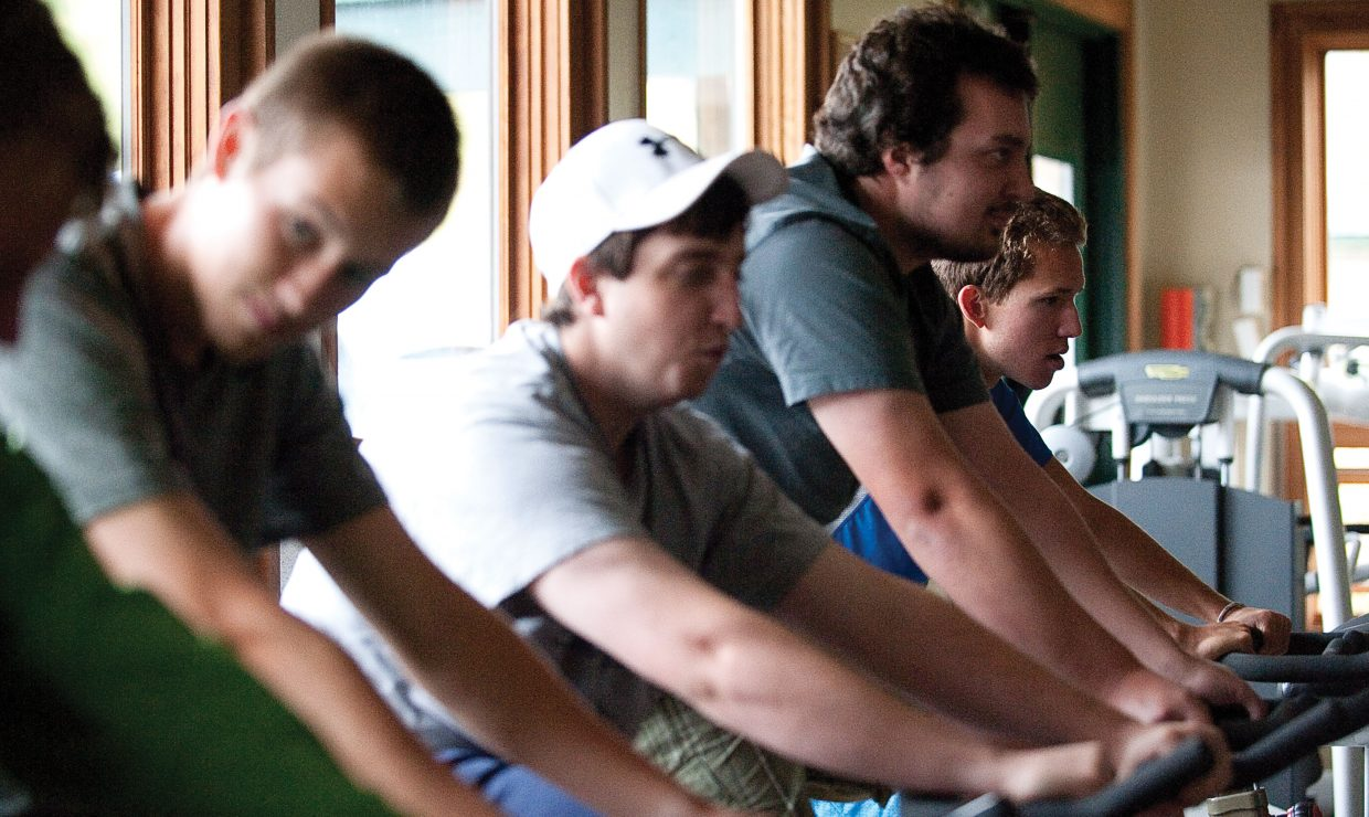 Members of the Colorado Mountain College ski team warm up before training Thursday at Howelsen Hill. The team has joined the Division I Rocky Mountain Intercollegiate Ski Association this season as an associate member.