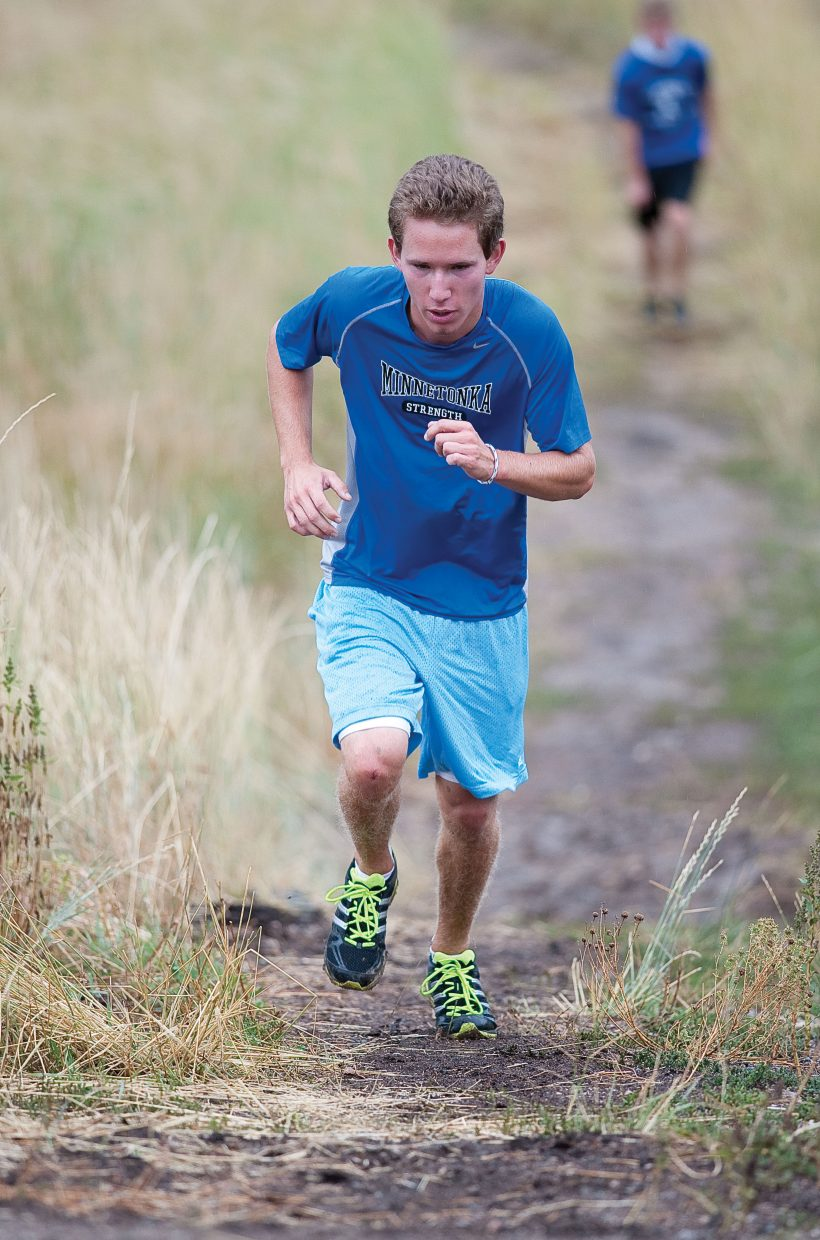 Colorado Mountain College skier Ben Capper runs up a hill during a training session at Howelsen Hill.