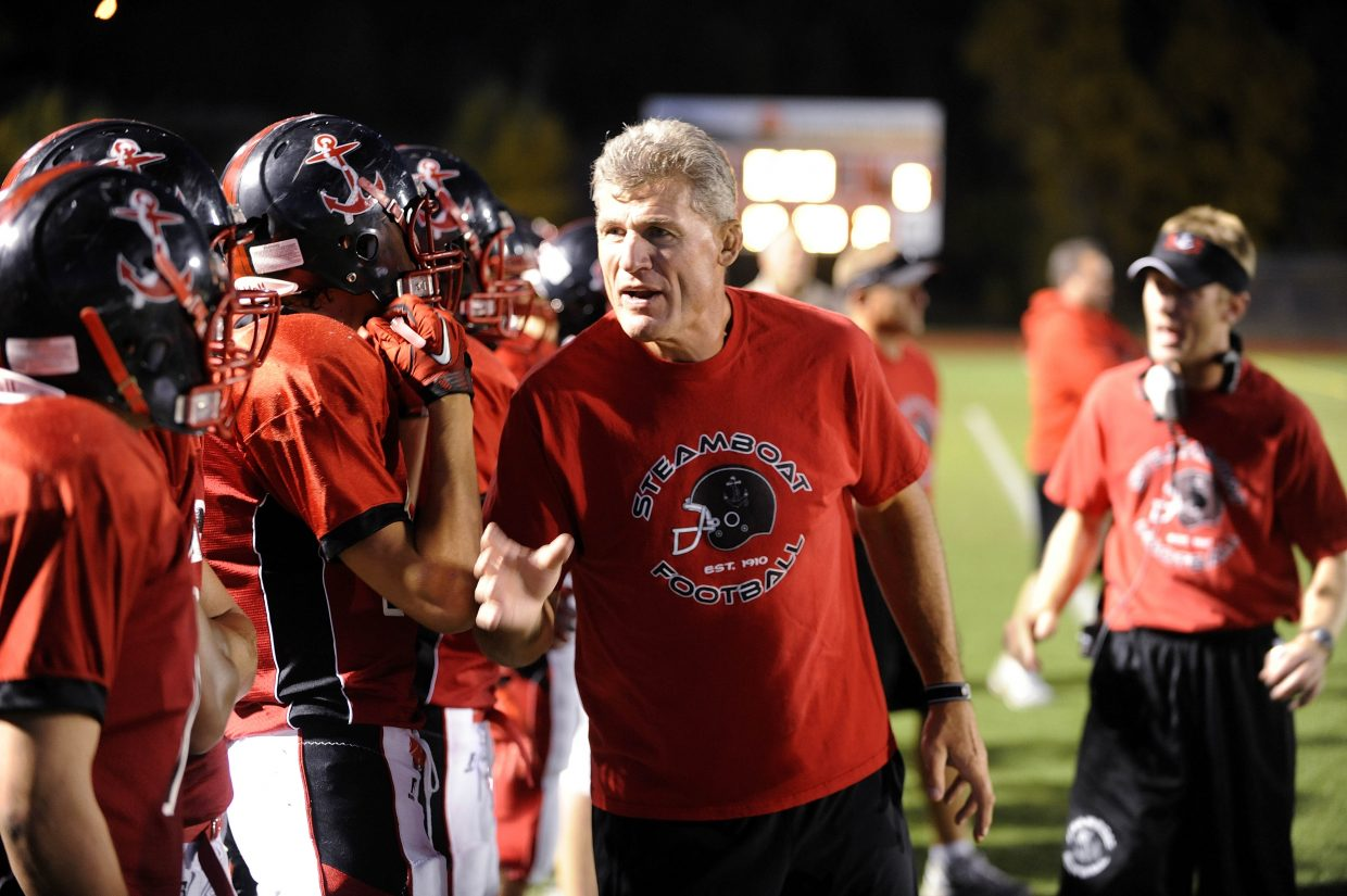 Tim Krumrie talks to his players during Friday night's game against Montrose.