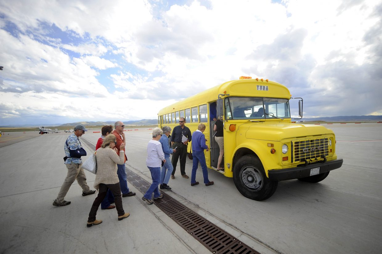 Yampa Valley Regional Airport visitors load a bus Wednesday during a tour of the airport. The airport will host two more behind-the-scenes tours as part of its 20-year master plan process.