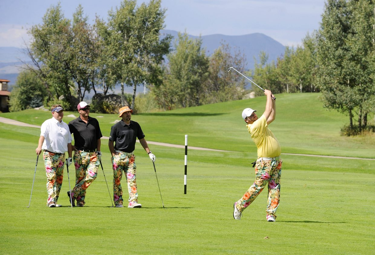 Steamboat Springs golfers, from left, Shad Townsend, Matt Townsend and Gable Richardela watch Drew Rissler take a shot during the 34th annual The Moose's Loose scramble golf tournament Wednesday at Rollingstone Ranch Golf Club. Money raised in the tournament goes to support the Steamboat Springs Winter Sports Club scholarship fund.