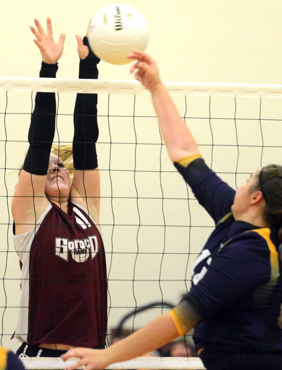 Soroco's Emilee Tritz reaches for a block Thursday against West Grand.