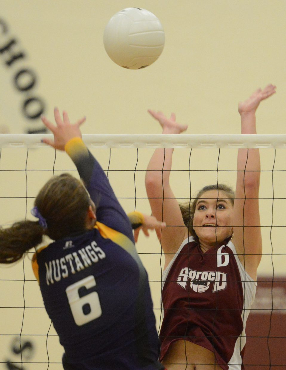 Soroco's Jacey Schlegel braces for a block Thursday against West Grand.