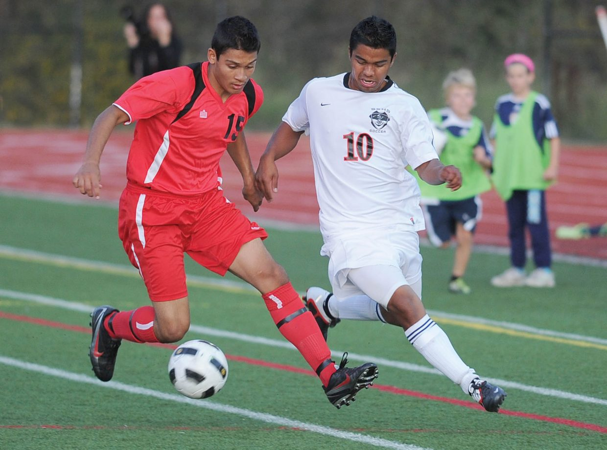 Glenwood Springs defender Jose Betancourt and Steamboat Springs' Enrique Lopez battle for a ball in the first half of Tuesday's soccer game at Gardner Field.