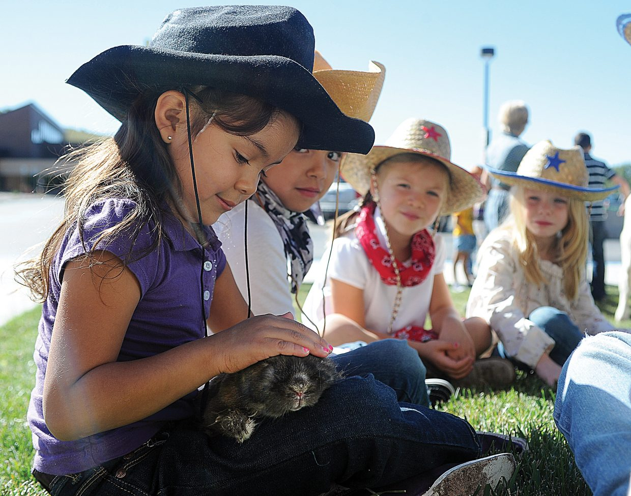 Strawberry Park Elementary School kindergartner Leslie Prieto pets a rabbit during Western Heritage Day at the school.
