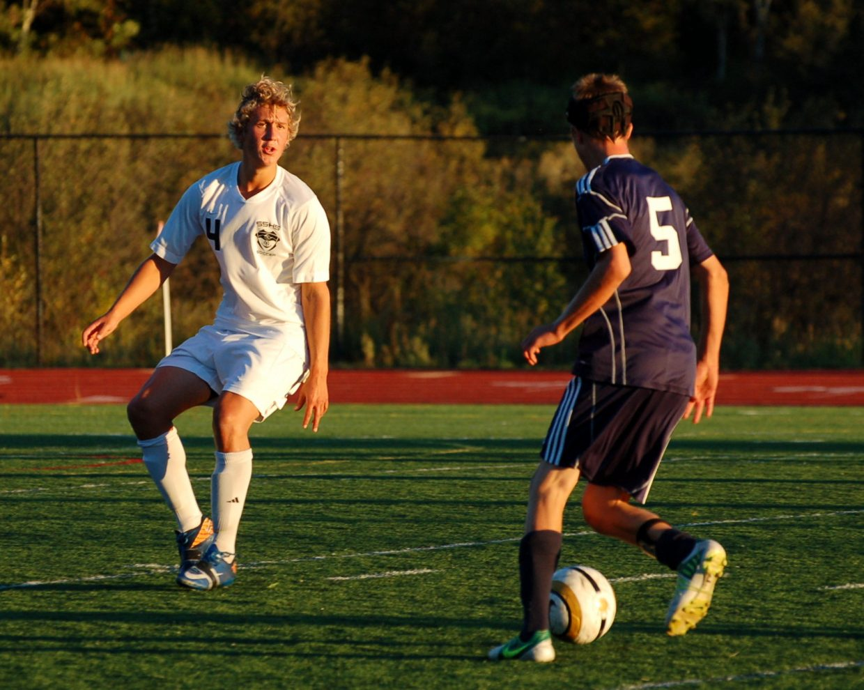 Ryan Walker looks to steal the ball for the Sailors.