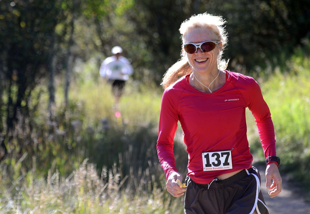 Pam Wooster runs Saturday in the Emerald Mountain Trail Run in Steamboat Springs.