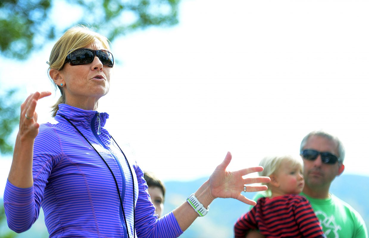 Cara Marrs announces winners at the end of the Emerald Mountain Trail Run as her husband, Dave, and son, Max, look on. Marrs is stepping down after four years helping lead the Steamboat Springs Running Series.