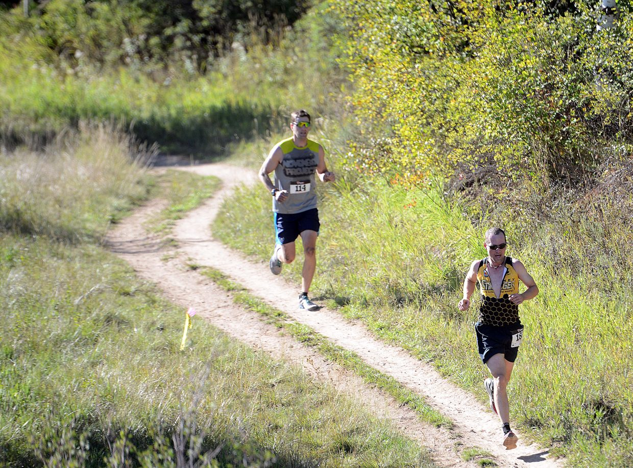 Harry Niedl, right, and Dan Berteletti run Saturday in the Emerald Mountain Trail Run in Steamboat Springs. Niedl was second in the race and first overall in the Steamboat Springs Running Series points race, winning that for the third time.