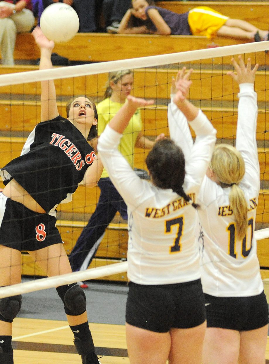 Hayden senior Morgan Bell swings hard Friday as her Tigers beat West Grand in four games.