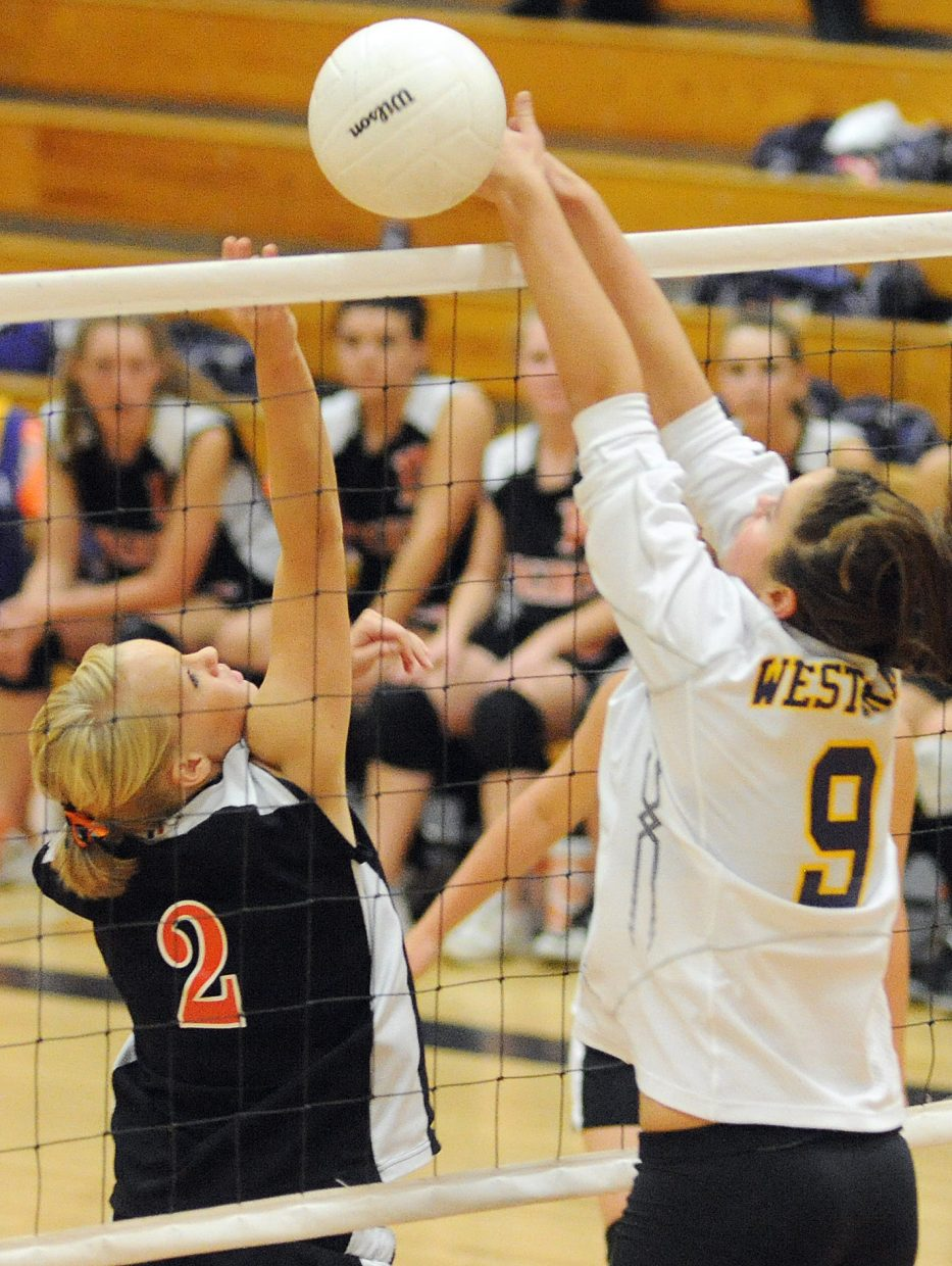 Hayden's Jacie Temple tips the ball past a West Grand defender on Friday.
