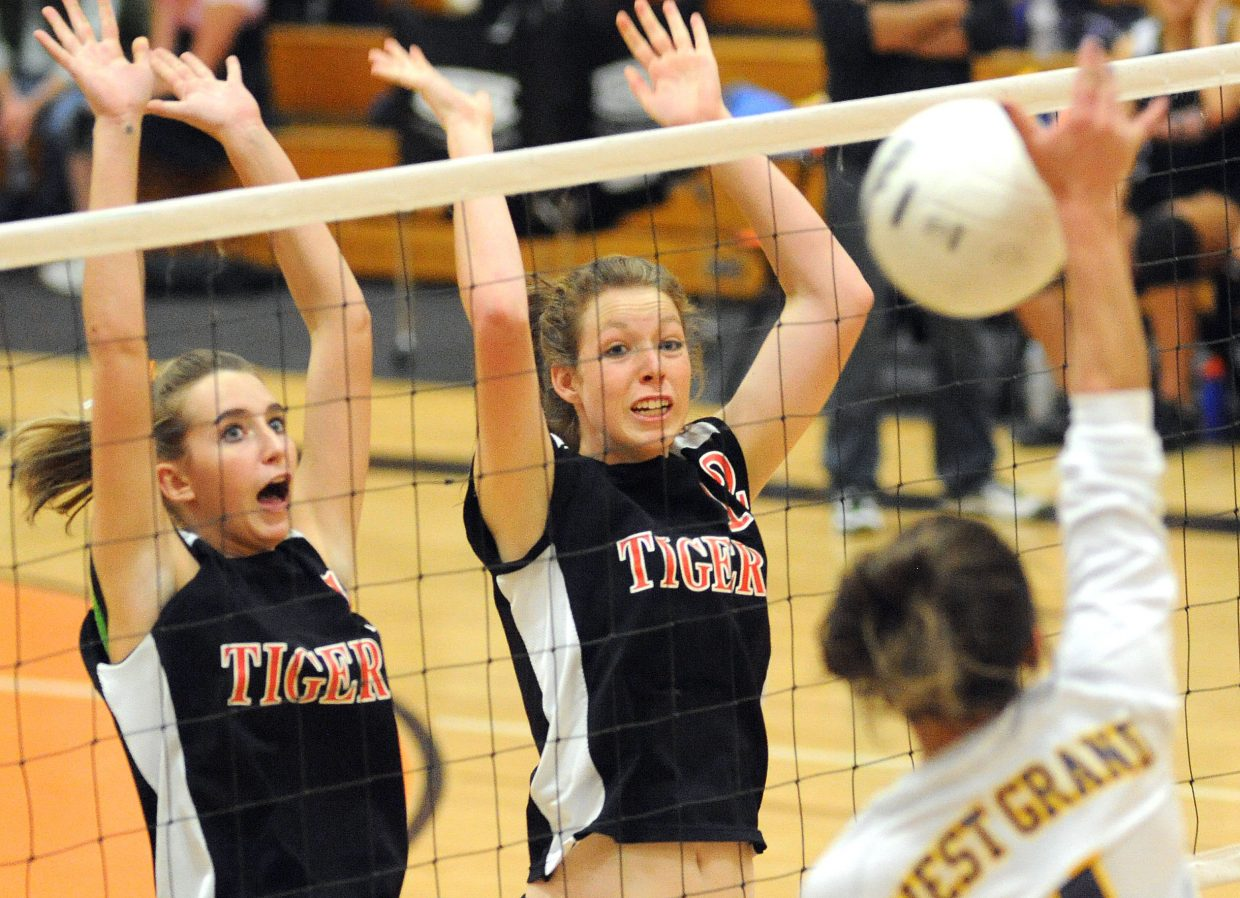 Hayden's Kali McFadden and Aubree Haskins go up for a block during Friday's four-game victory against West Grand.