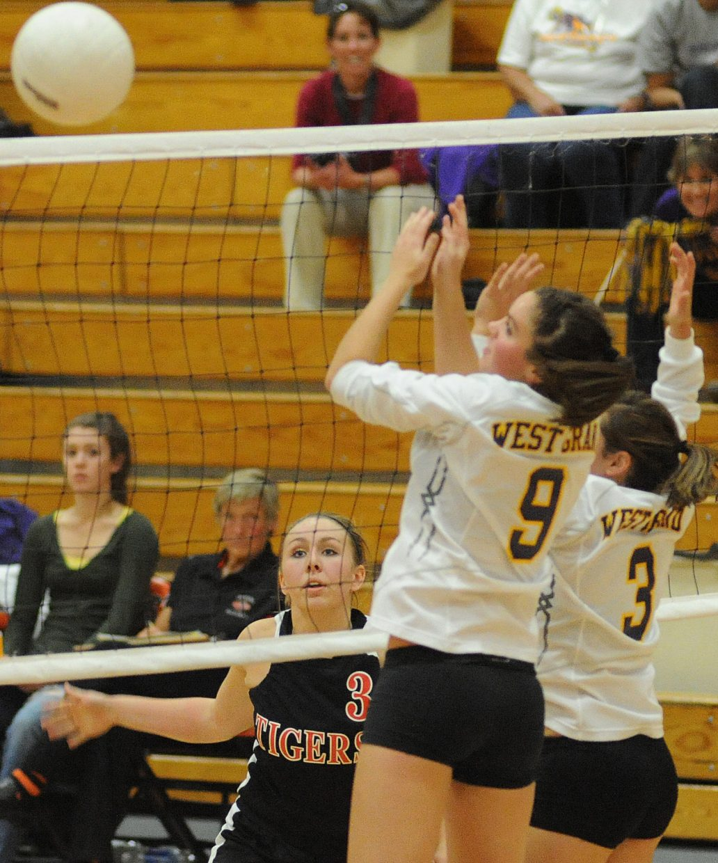 Hayden's Brette Frentress watches a ball she struck sail past the West Grand defense on Friday as the Tigers beat the Mustangs in four games.