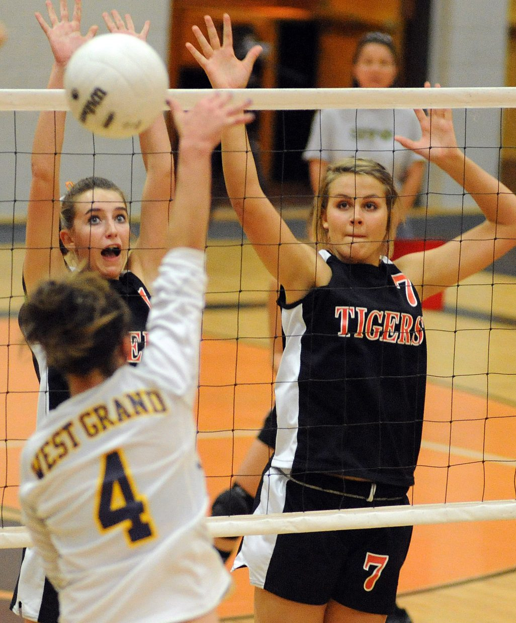 Hayden's Kali McFadden and Erin Koehler go for the block on Friday against West Grand.