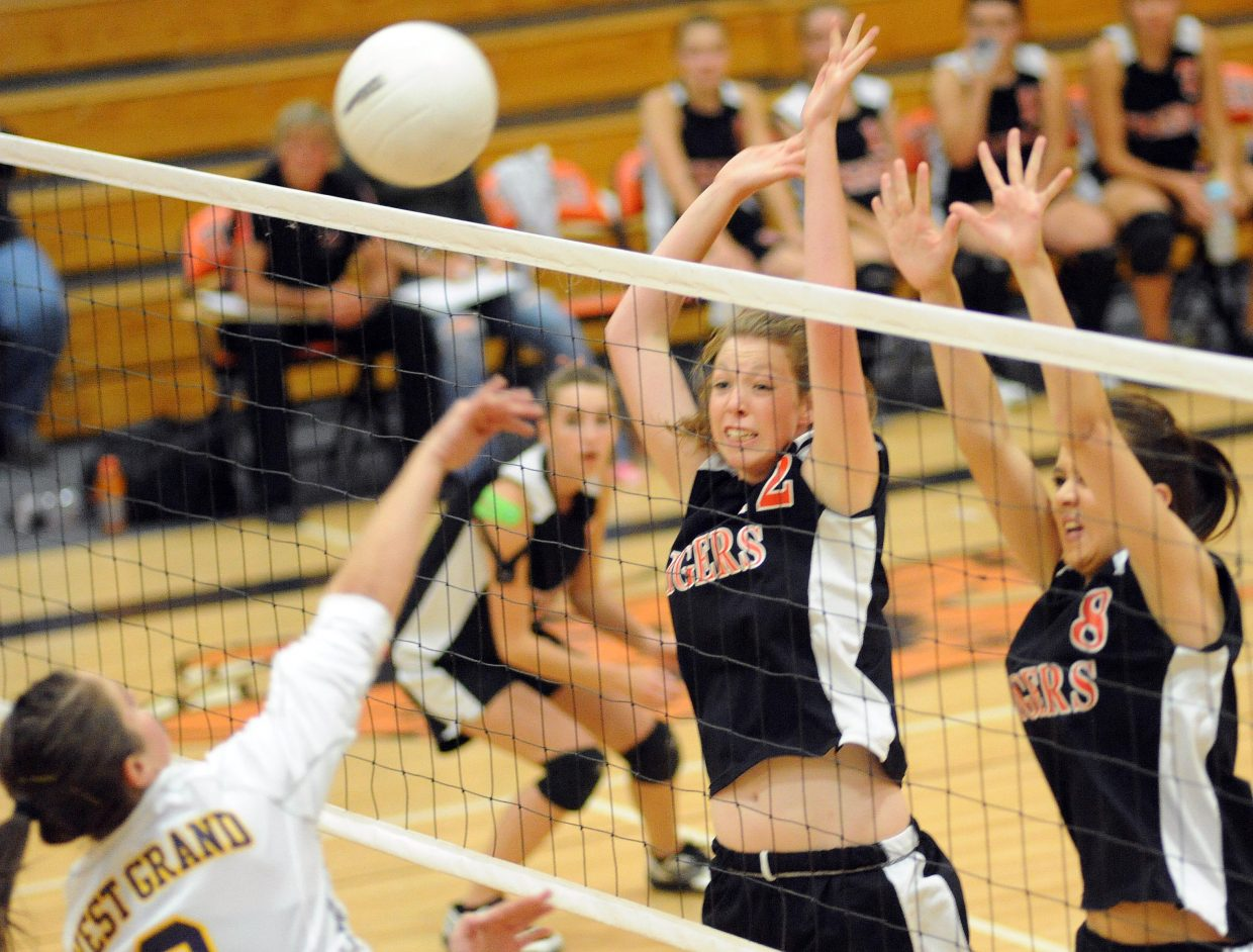 Hayden's Aubree Haskins and Morgan Bell try to get an arm on a West Grand hit on Friday.