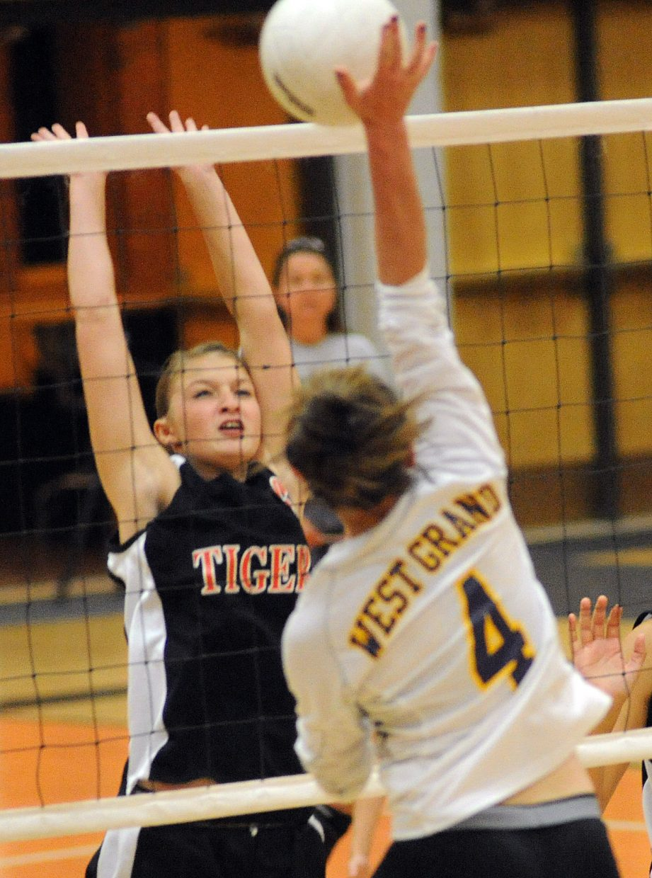 Hayden's Olivia Zehner tries for a block Friday against West Grand.