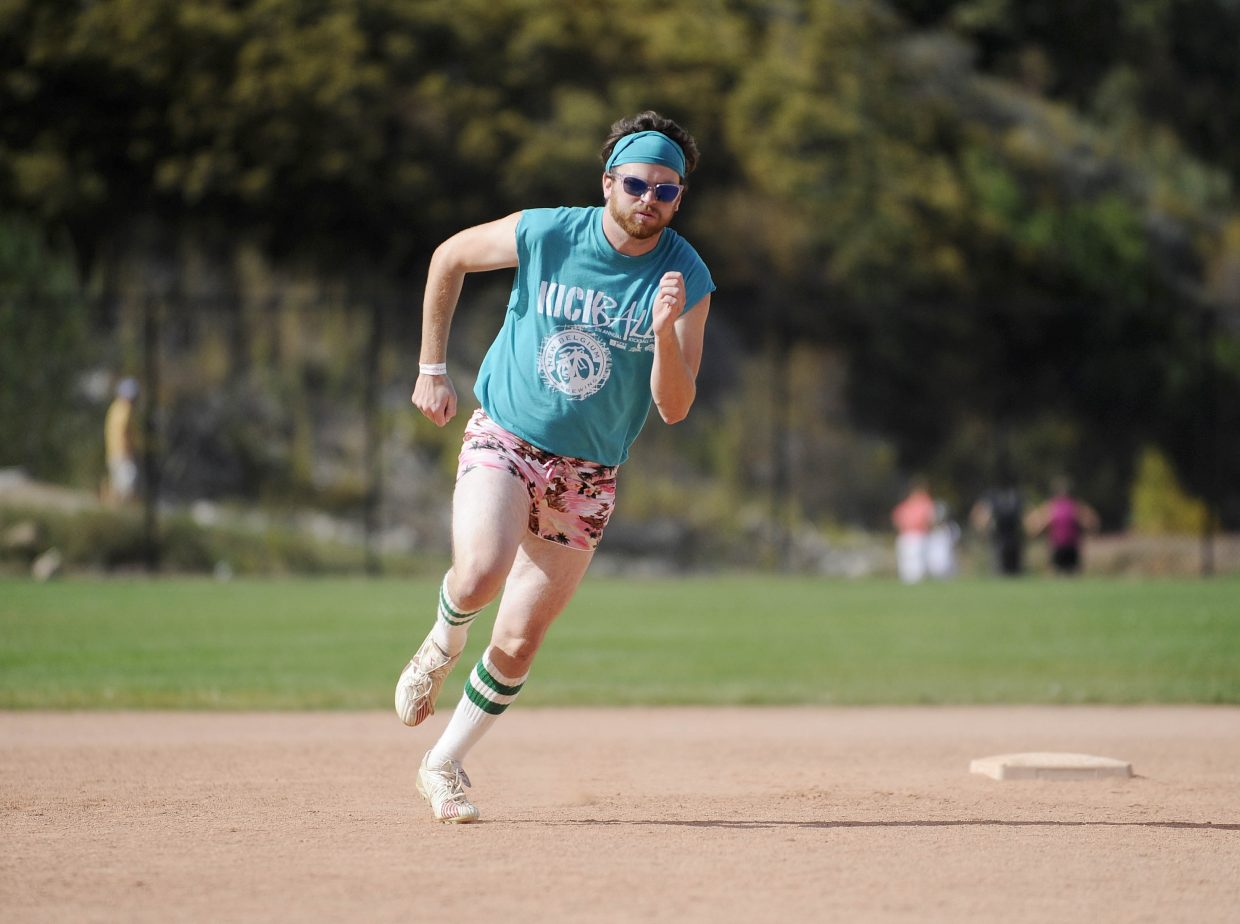 Step Daddys team member Andy Cheesebro rounds second base during Saturday's New Belgium Kickball Klassic at Howelsen Hill. There were 32 teams with more than 500 people participating in the fifth annual event.
