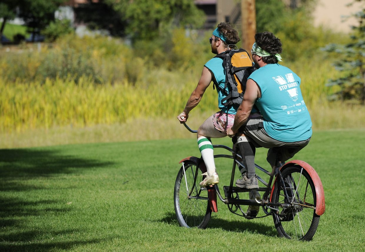 Step Daddys teammates Adam Weitzel, right, and Andy Cheesebro ride a tandem bike after winning a game during Saturday's New Belgium Kickball Klassic at Howelsen Hill.