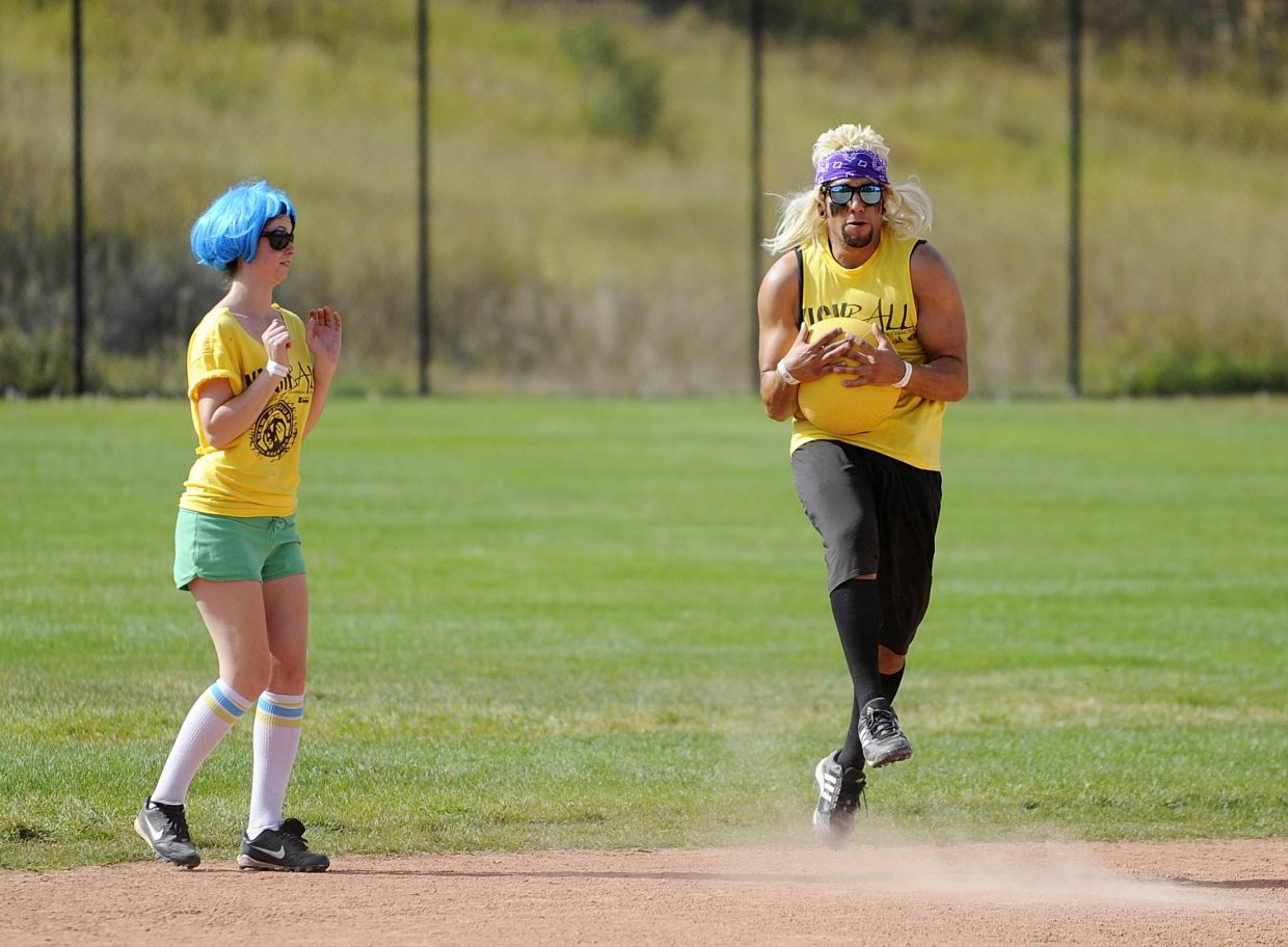 Heidi Blackmar watches Mata catch the ball during Saturday's New Belgium Kickball Klassic at Howelsen Hill.