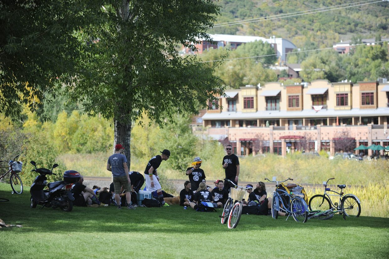 Blacksheep team members sit in the shade during Saturday's New Belgium Kickball Klassic at Howelsen Hill.