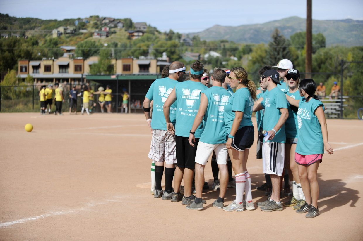 Step Daddys team members say a cheer during Saturday's New Belgium Kickball Klassic at Howelsen Hill.