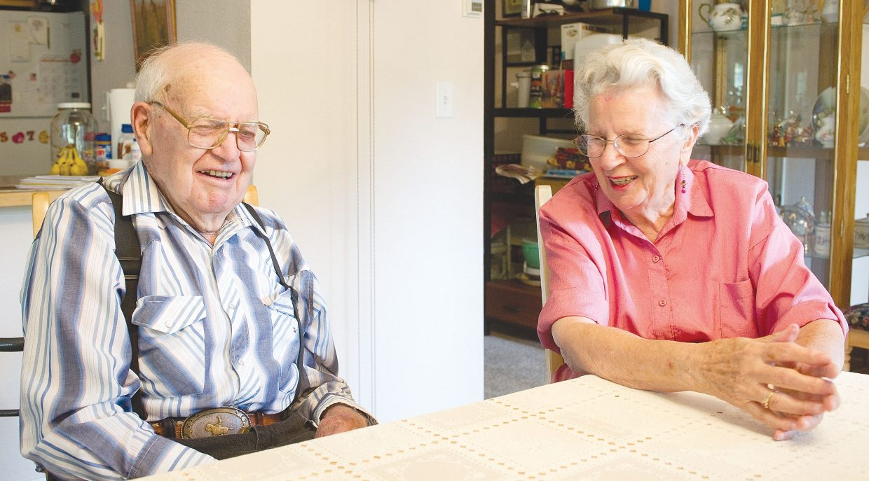 Betty and Lewis Kemry share a laugh while talking about the day they met each other.