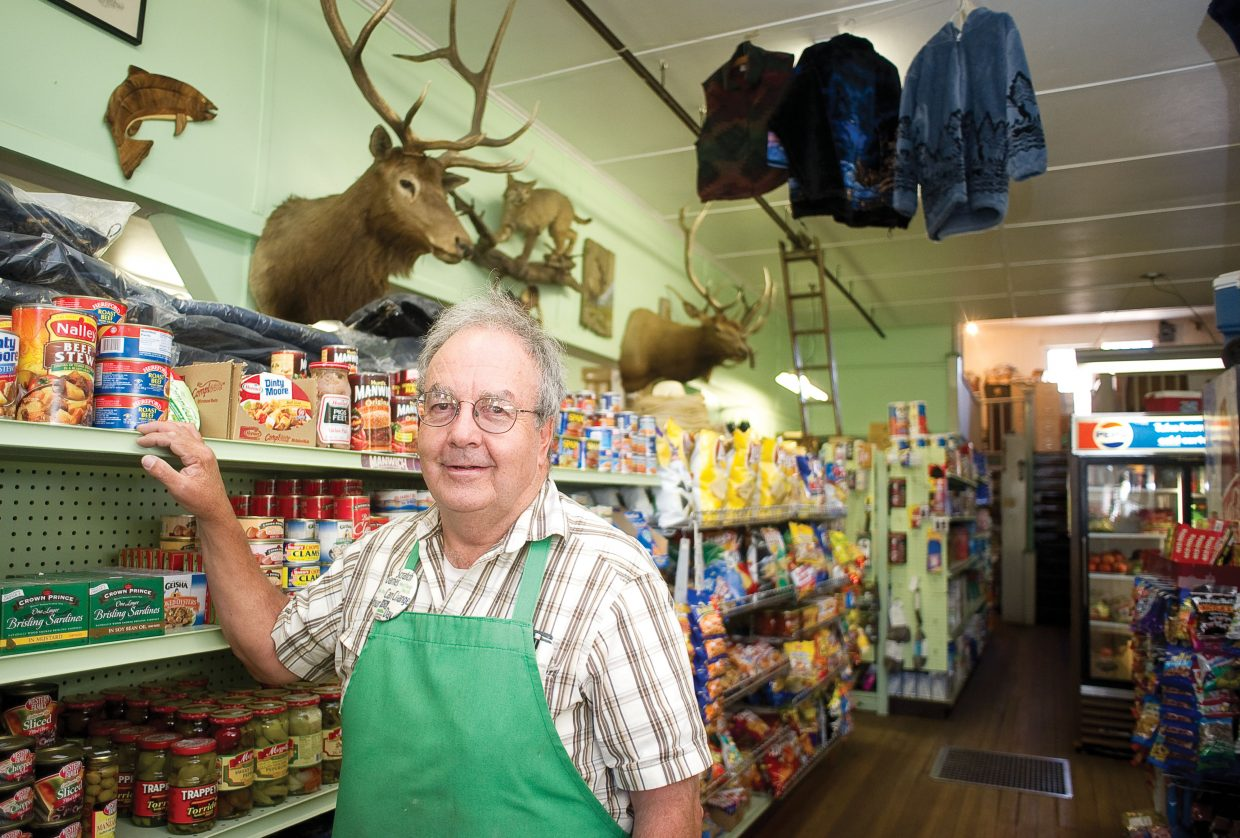 Ken Montgomery stands in the general store that his family has owned in Yampa for generations. Yampa businesses have gotten a boost recently from hunters.