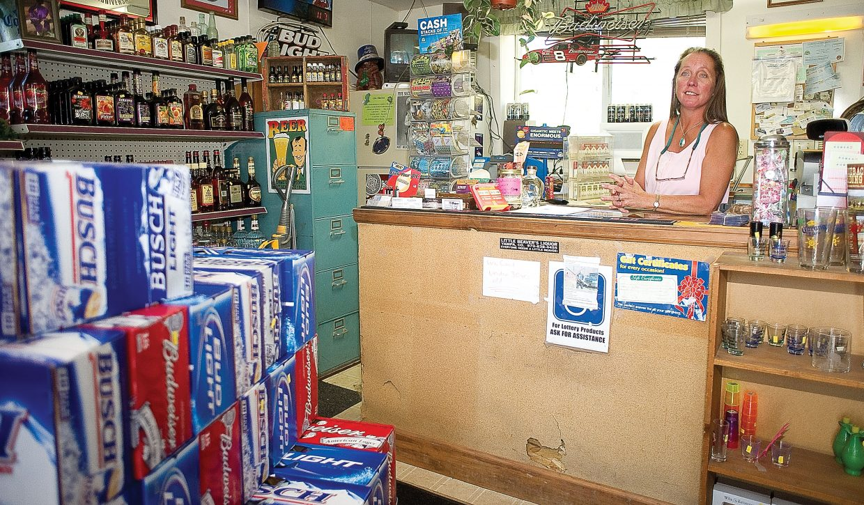 Teresa Northrop, owner of the Little Beavers Liquor Store in Yampa, is hoping that another strong rifle season will keep customers coming through the doors.