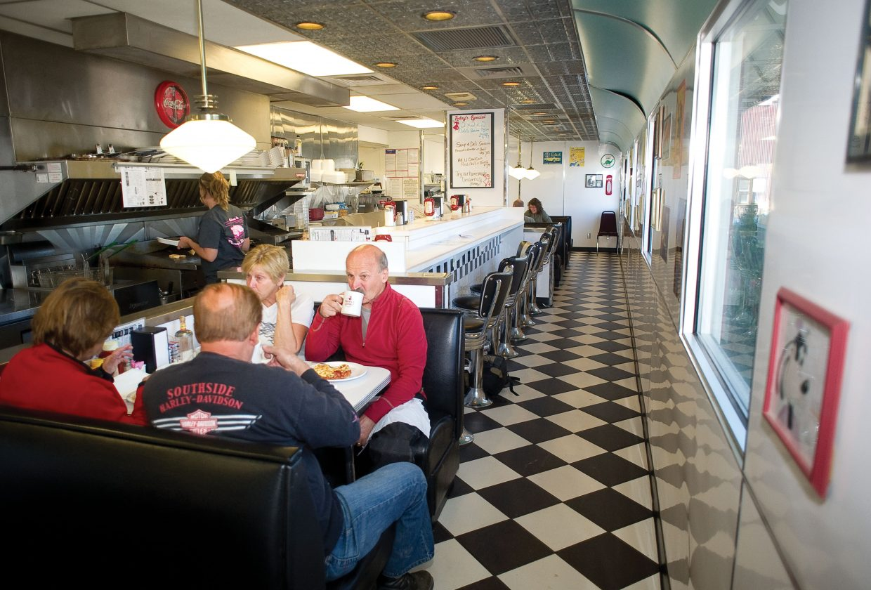 Jerry Jannette and his wife, Bobbi, front, and Dan Jannette and his wife, Linda, have lunch at Penny's Diner in Yampa last week. The couples were touring the area on their motorcycles.