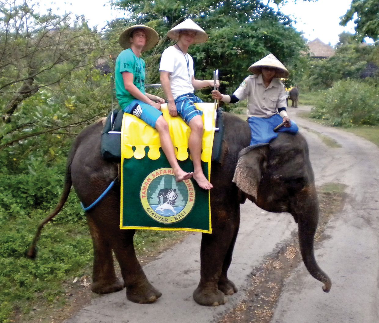 Kaleb Mckey, left, rides atop an elephant during a spring break trip to Bali, Indonesia. He and his roommate, Didrik, middle, were on break from their study abroad program in Adelaide, Australia