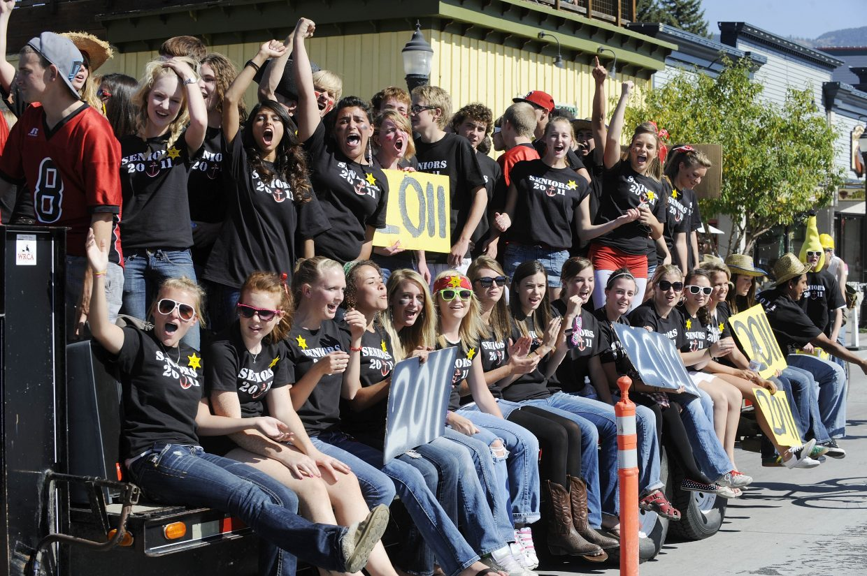 Members of the Steamboat Springs High School senior class ride in Friday's homecoming parade through downtown Steamboat Springs.