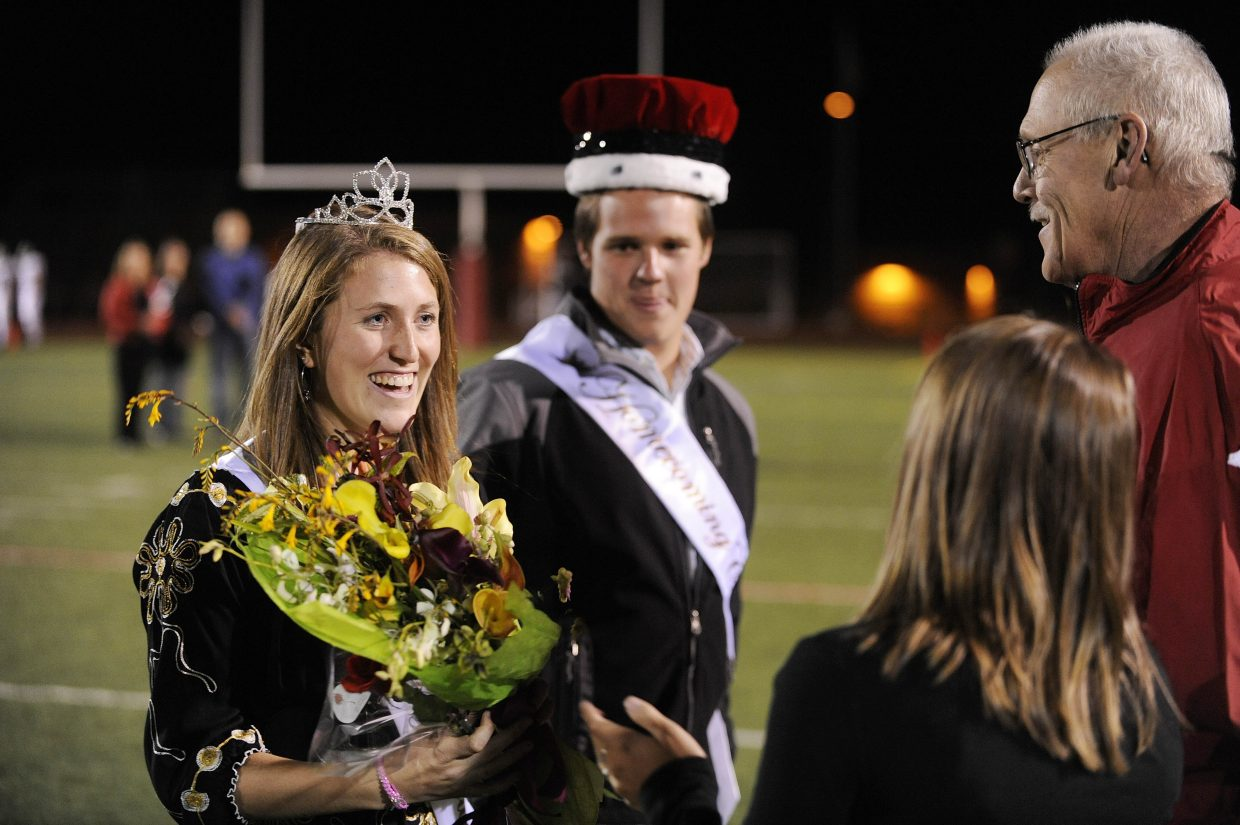 Steamboat Springs High School seniors Meghan Lukens and Patrick Weston are crowned homecoming king and queen by Dennis Hensen and Kayleigh Esswein at Friday night's football game.