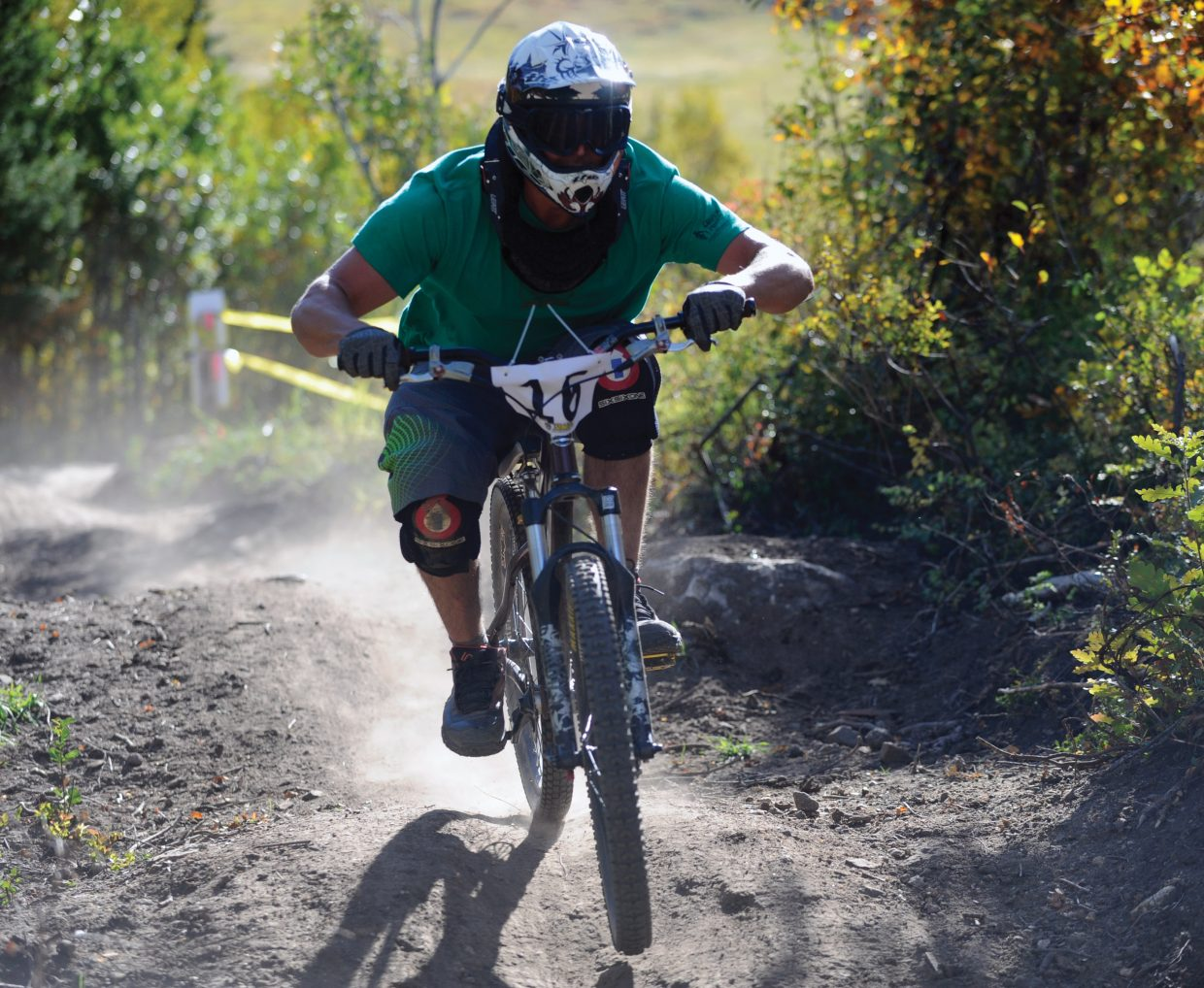 Geoff Hollister rides down the Bucking Bronco downhill trail Sunday during the second annual Bike Summit Downhill race.