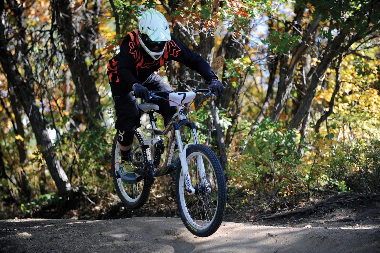 Ross Kirby flies over a jump near the bottom section of Sunday's second annual Bike Summit Downhill race.
