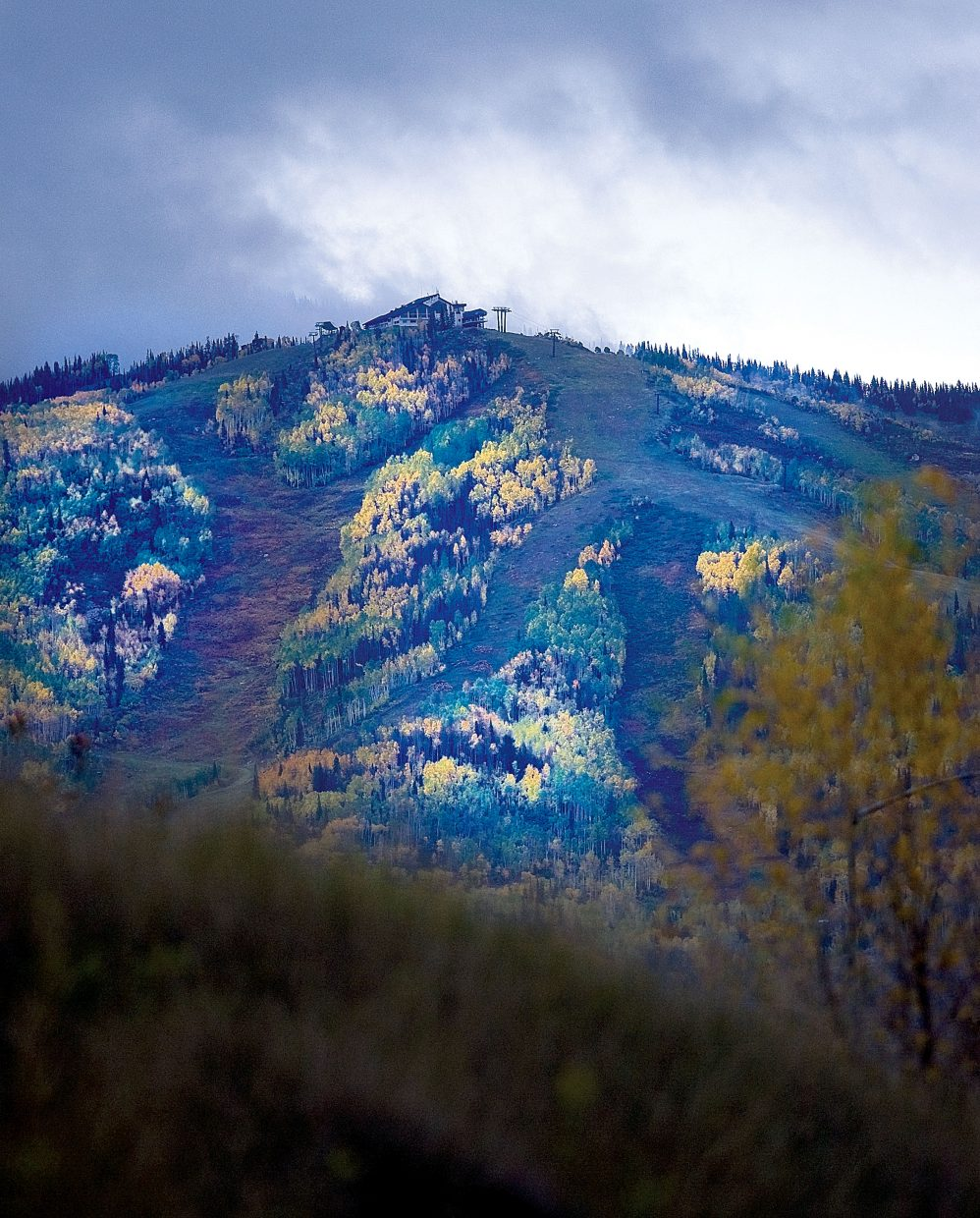 Threatening clouds hang over the slopes of the Steamboat Ski Area on Thursday morning. The first snow of the season fell Thursday.