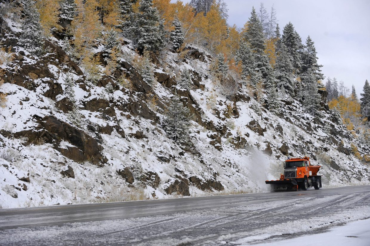 A Colorado Department of Transportation plow truck clears snow on U.S. Highway 40 after Thursday's storm.